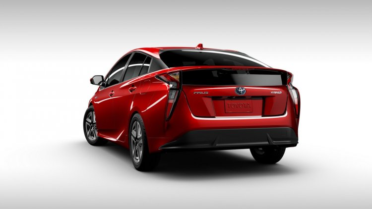 2016 Toyota Prius red rear three quarters view North American specification official image