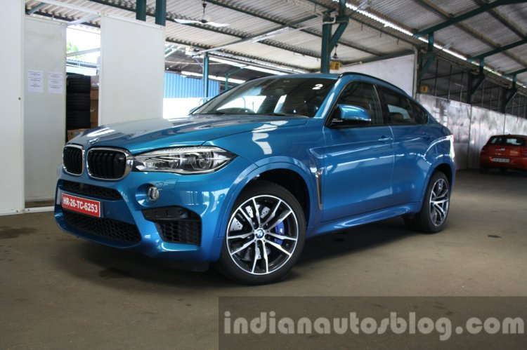 2015 BMW X6 M front three quarter with turn-in first drive review