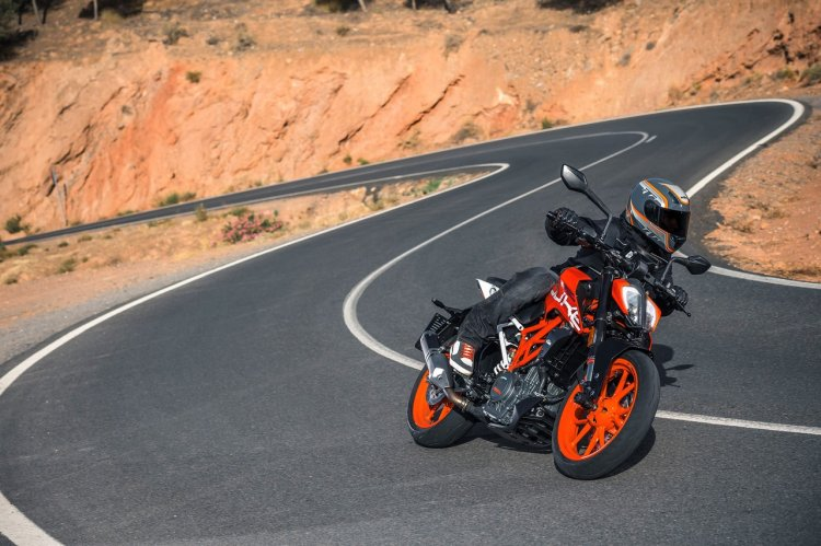 2017 KTM Duke 390 front three quarters in motion