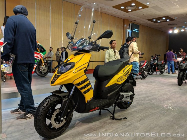 Aprilia Storm Yellow with accessories front left quarter at 2018 Auto Expo