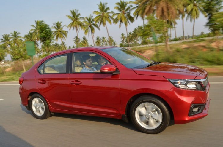 Honda Amaze VX CVT side profile action photo