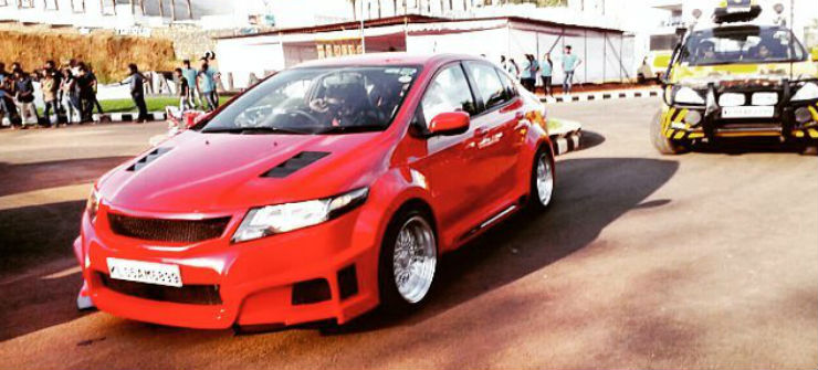 Modified Honda City Red Front Three Quarters Image