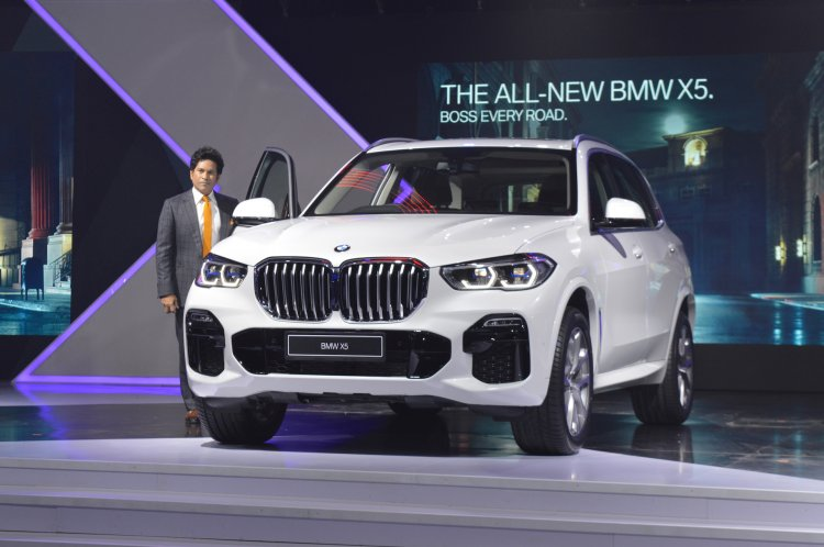 2019 BMW X5 Mineral White Front Three Quarters With Sachin Tendulkar