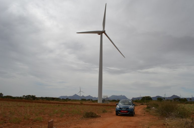 2013 Nissan Micra by a windmill