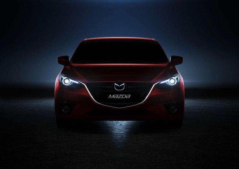 Mazda3 headlamps illuminated in the dark
