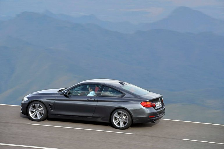 rear left three quarter angle of the grey 2014 BMW 4 Series Coupe