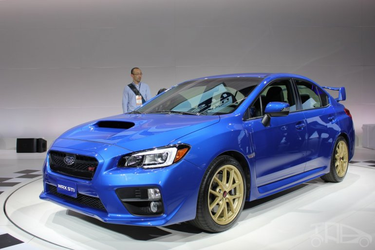 2015 Subaru WRX STi front three quarters right at NAIAS 2014