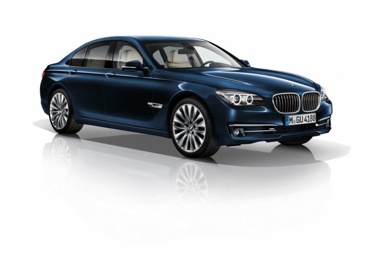 BMW 730d Edition Exclusive Imperial Blue front three quarter press shot