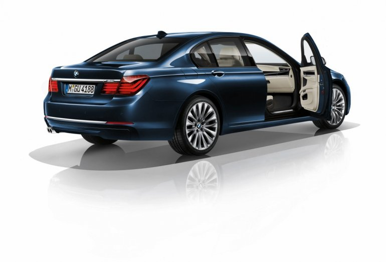 BMW 730d Edition Exclusive Imperial Blue rear three quarter press shot