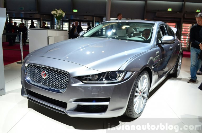 Jaguar XE front three quarters left at the 2014 Paris Motor Show