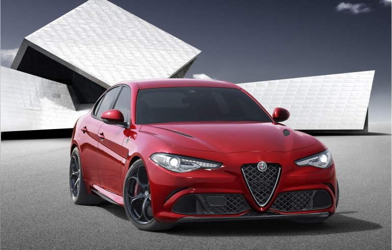 2016 Alfa Romeo Giulia front three quarter unveiled press shot