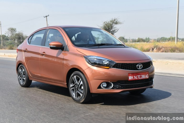 Tata Tigor petrol front three quarter highway First Drive Review