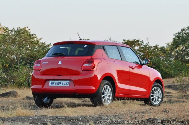 2018 Maruti Swift test drive review rear three quarters view